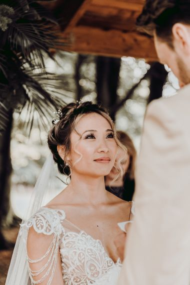 Beautiful bride listing to her groom say his vows