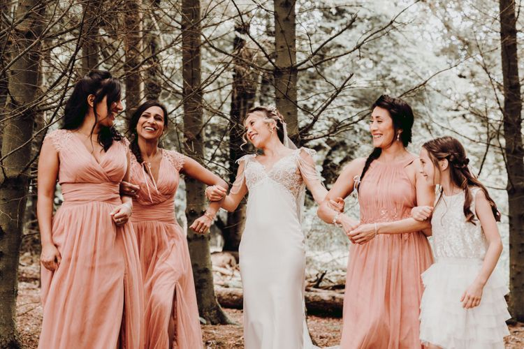 Bride with bridesmaids in pink dresses at Charisworth Farm wedding