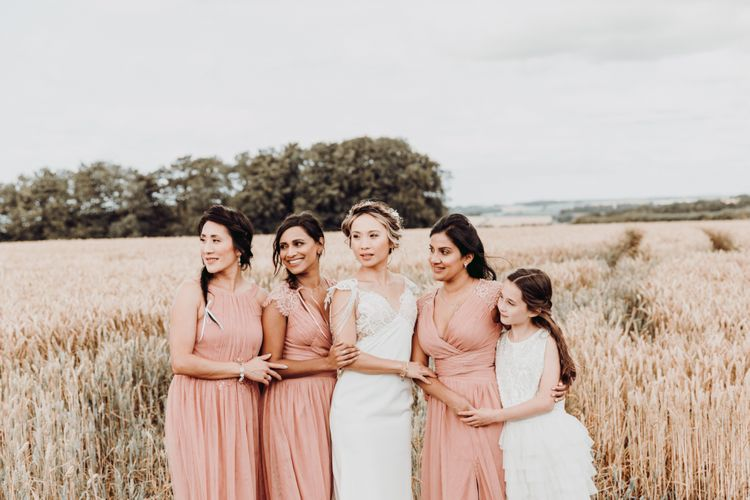 Bridal party portrait in a wheat field by Romy Lawrence Photography