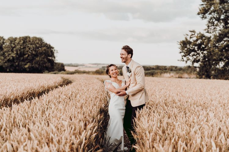 Bride and groom portrait in the wheat fields at Charisworth Farm by Romy Lawrence Photography