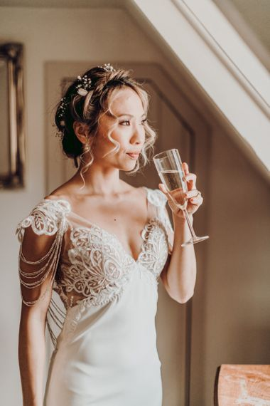 Bride sipping champagne on the wedding morning