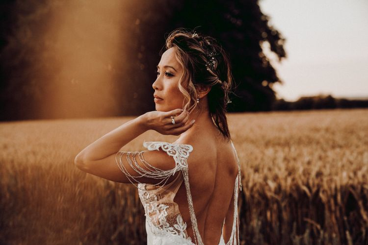 Bride in backless wedding dress with sleeve detail