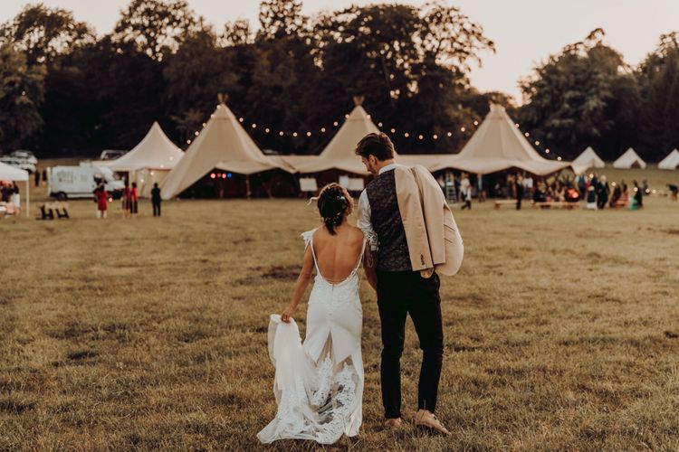 Bride and groom at outdoor teepee reception at Charisworth Farm