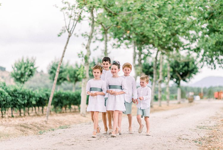 Flower girls and page boys in white and green outfits