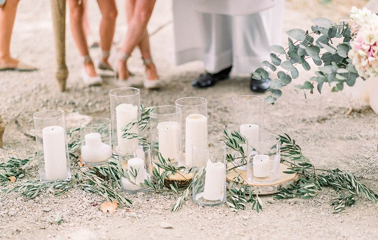 Olive branches and candles wedding decor