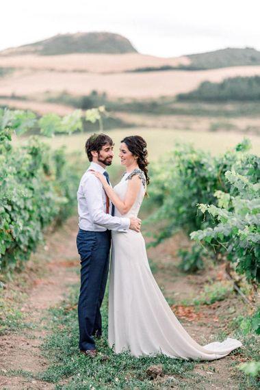 Bride in silk wedding dress with embellished shoulder detail