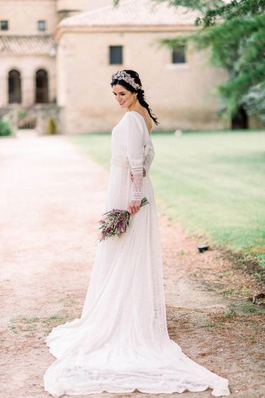Victoria Imaz wedding dress with lace cuffs and long detachable train holding an astilbe wedding bouquet