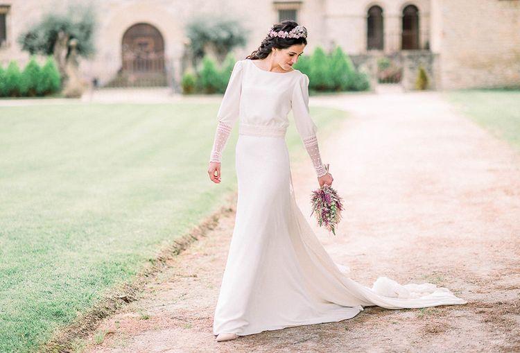 Bride in Victoria Imaz wedding dress holding an astilbe wedding bouquet