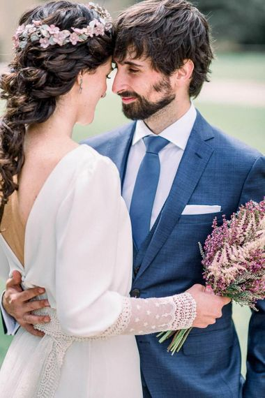 Bride with French plait holding an astilbe wedding bouquet