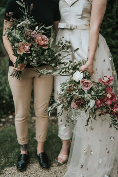 Two brides with complementing wedding bouquets