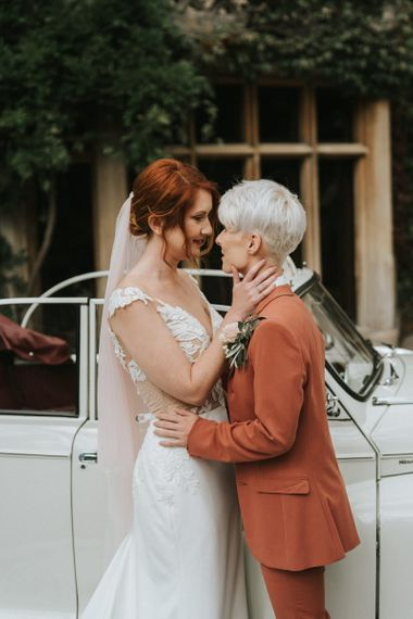 Bride with short hair in coloured wedding suit