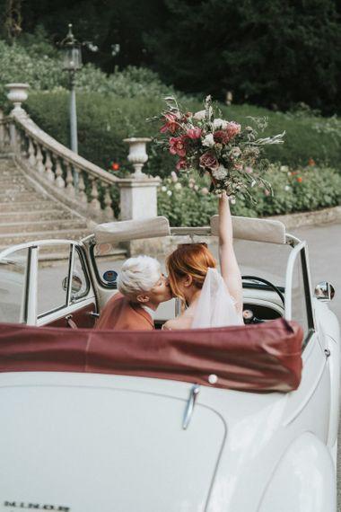 Brides in a wedding car for LGBTQ+ wedding inspiration