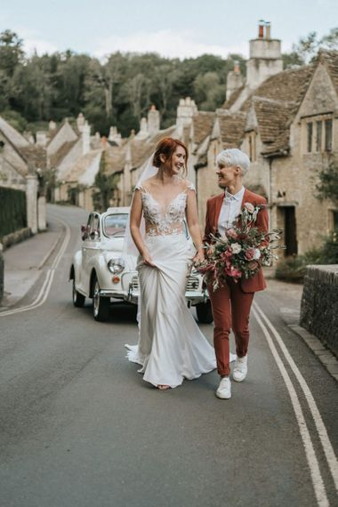 Same-sex marriage with brides in a wedding dress and coloured suit