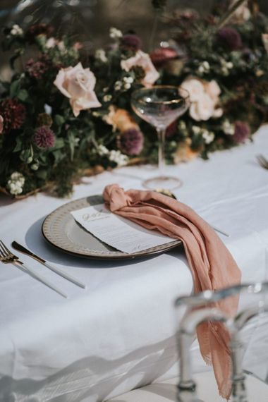 place setting with blush linen napkin