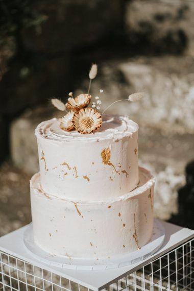 buttercream wedding cake with gold decor