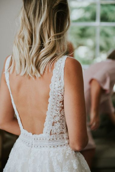 Backless Enzoani wedding dress with lace detail