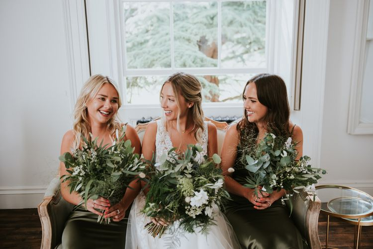 Bridal party on wedding morning holding foliage bouquets