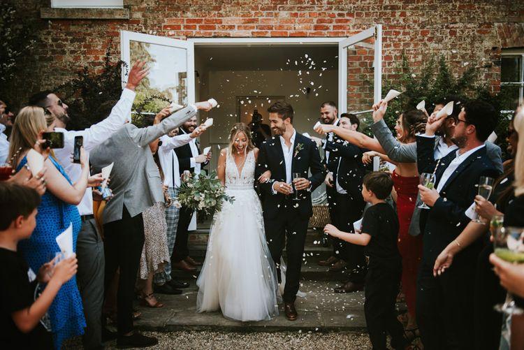 Confetti exit at Aswarby Rectory wedding
