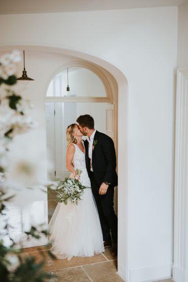 Bride and groom kissing inside Aswarby Rectory wedding venue