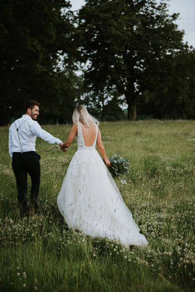 Bride in backless lace and tulle Enzoani wedding dress