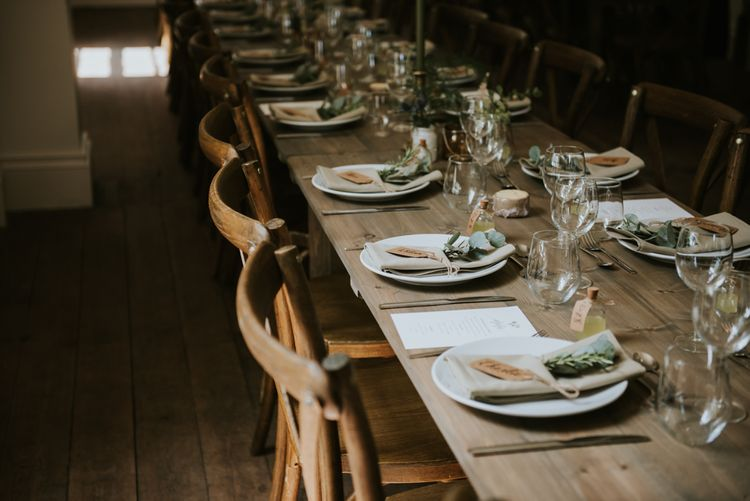 Natural place setting with linen napkin and foliage sprig