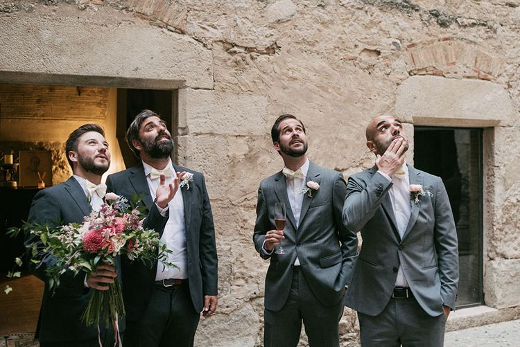 Groomsmen in Grey Suits & Pink Bow Ties | Luxe Blush Pink Glasshouse Wedding at Cortal Gran, Spain Planned by La Puta Suegra  | Sara Lobla Photography