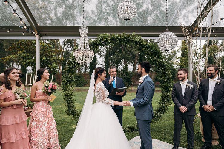 Wedding Ceremony | Bride in Rosa Clara Gown | Groom in Grey Suit & Bow Tie | Luxe Blush Pink Glasshouse Wedding at Cortal Gran, Spain Planned by La Puta Suegra  | Sara Lobla Photography