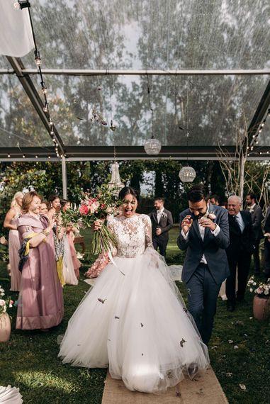 Confetti Exit | Bride in Rosa Clara Princess Gown | Groom in Grey Suit | Luxe Blush Pink Glasshouse Wedding at Cortal Gran, Spain Planned by La Puta Suegra  | Sara Lobla Photography