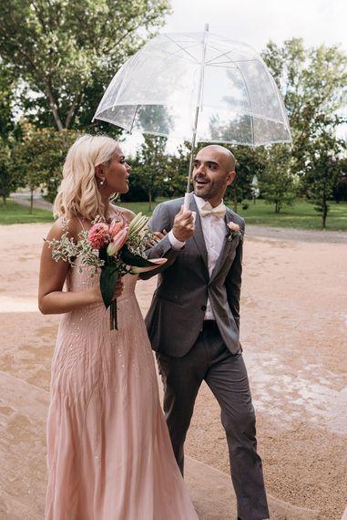 Groomsman in Grey suit | Bridesmaid in Pink Dress | Luxe Blush Pink Glasshouse Wedding at Cortal Gran, Spain Planned by La Puta Suegra  | Sara Lobla Photography