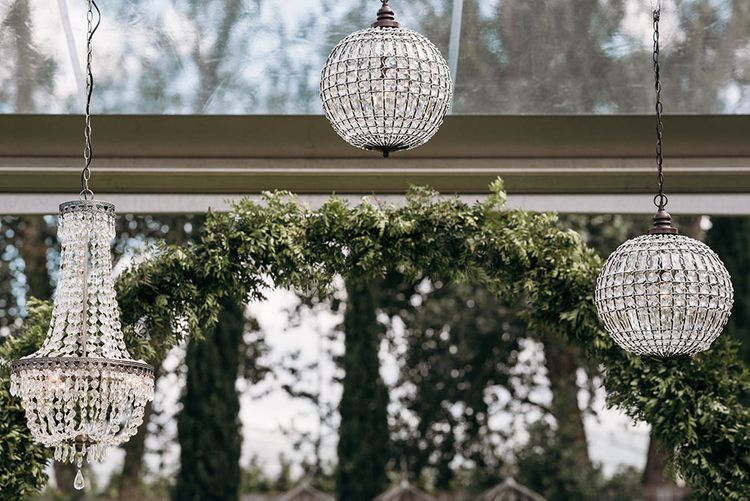 Chandelier Wedding Decor | Luxe Blush Pink Glasshouse Wedding at Cortal Gran, Spain Planned by La Puta Suegra  | Sara Lobla Photography