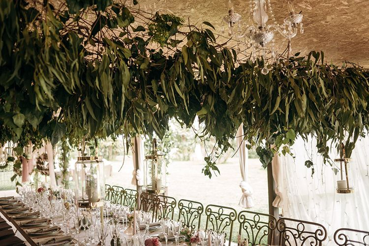 Foliage Hanging Installation over Reception Table | Luxe Blush Pink Glasshouse Wedding at Cortal Gran, Spain Planned by La Puta Suegra  | Sara Lobla Photography