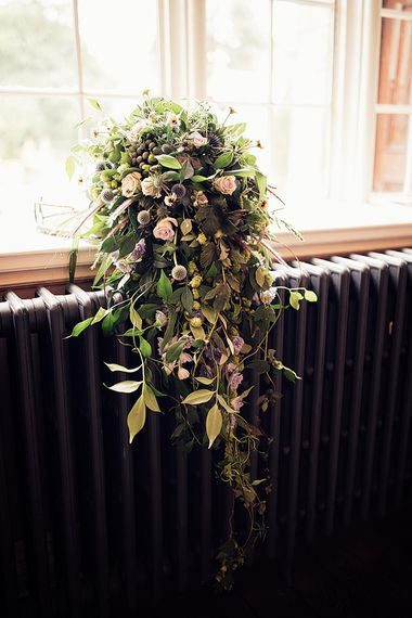 Cascading wedding bouquet with rose and foliage