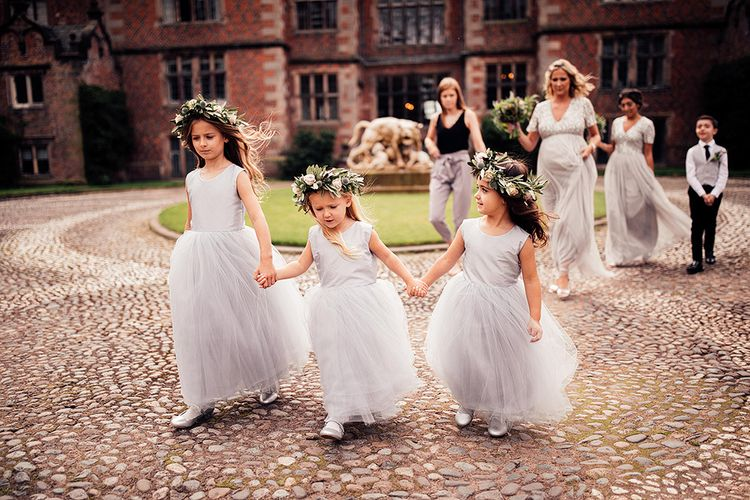 Flower girls in grey tulle dresses and flower crowns