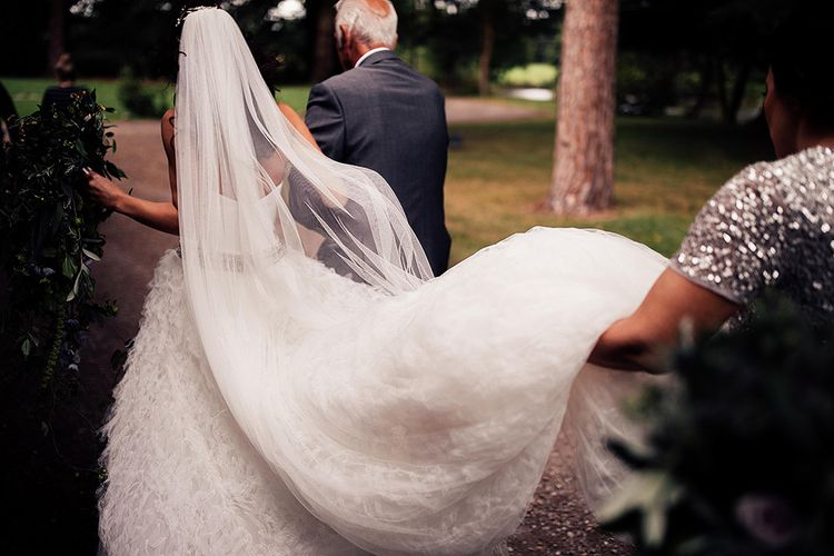 Bride in ruffle skirt and long wedding veil