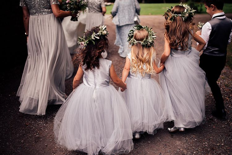 Cute flower girls in silver dresses and flower crowns