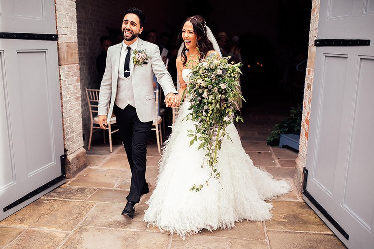 Bride in separates and groom in grey blazer and matching waistcoat