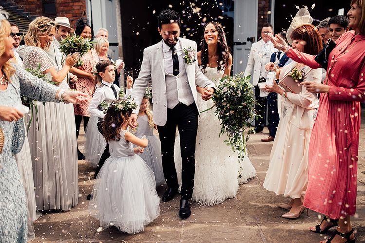 Family confetti exit at Dorfold Hall wedding venue