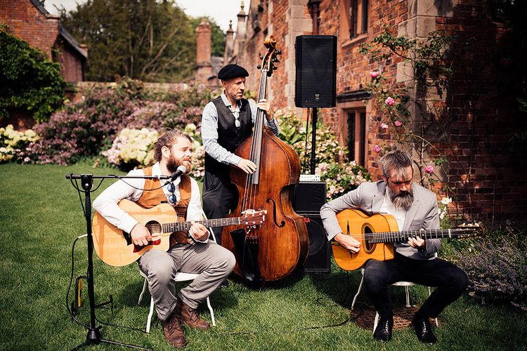 Wedding band playing on the lawn at Dorfold Hall