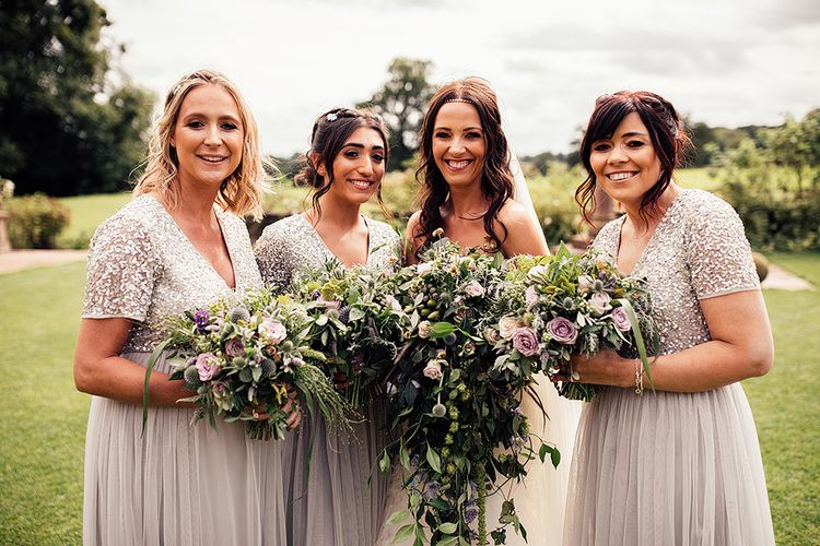 Bridal party with bridesmaids in grey sequin and tulle dresses