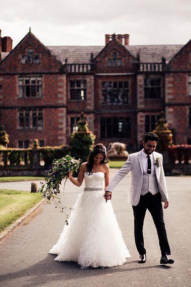Bride in separates and groom in grey blazer at Dorfold Hall wedding