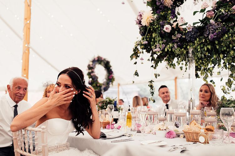 Bride laughing during the wedding speeches