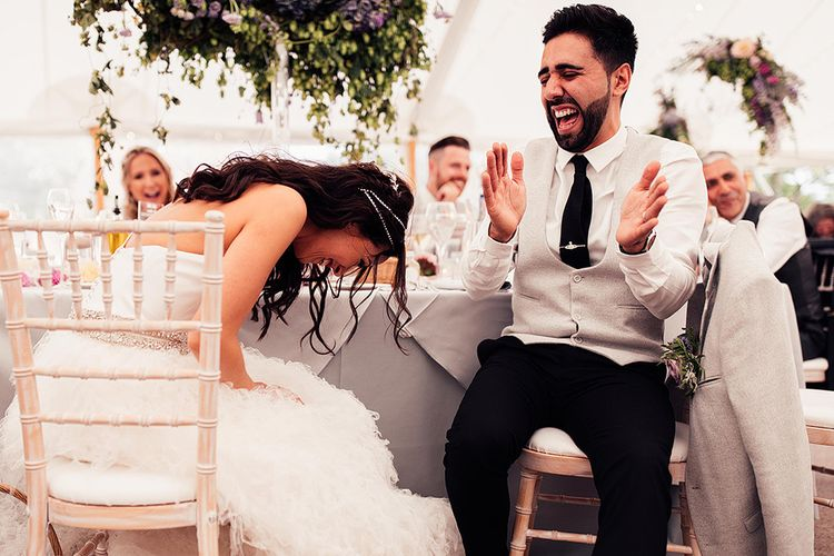 Bride and groom laughing during the Dorfold Hall wedding reception speeches