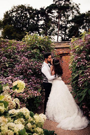 Intimate wedding portrait in Dorfold Hall gardens