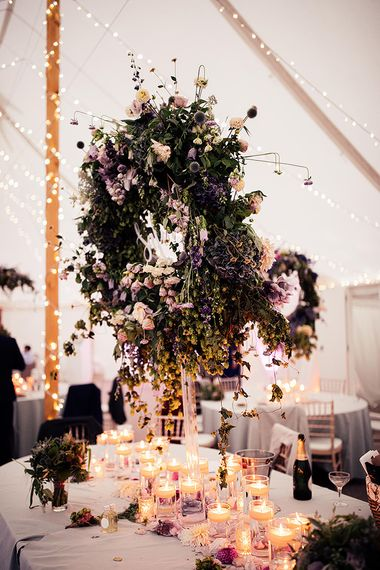 Floral hoop wedding decor and candle light at Dorfold Hall wedding reception