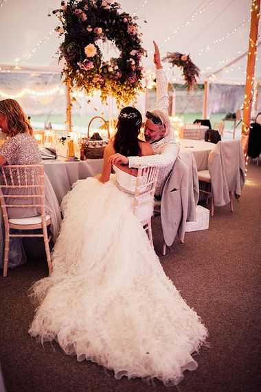 Bride in pronovnas wedding skirt at Dorfold Hall wedding reception