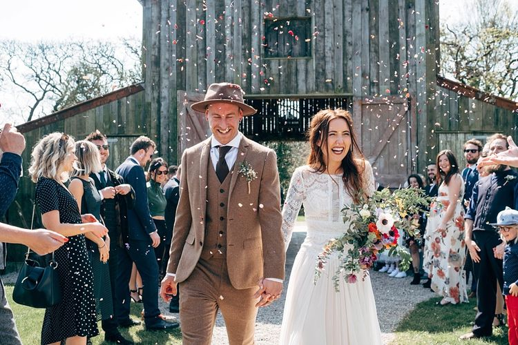 Just Married // Rusty Barn Wedding Ceremony Space At Nancarrow Farm // Nancarrow Farm Cornwall Wedding With Images From Dale Weeks & Bride In Maggie Sottero With Wild Flower Bouquet & Hand Knitted Flower Girl Outfit