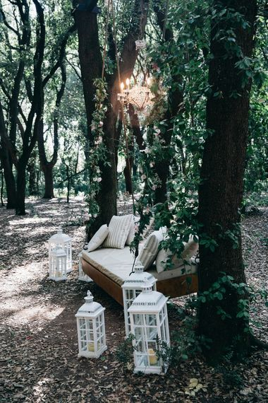 Outdoor Wedding Ceremony Decor | Soft Chair Swing Suspended from Trees | Large White Lanterns | Outdoor Chandelier | Puglian Countryside Wedding with Fairy Light Altar and Olive Grove Aperitivo | Figtree Wedding Photography