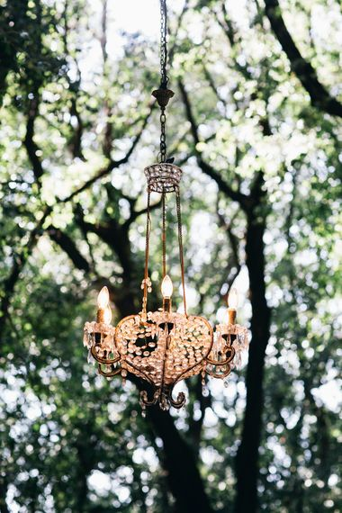 Outdoor Wedding Ceremony Decor | Chandelier Suspended from Trees | Outdoor Wedding Ceremony Decor