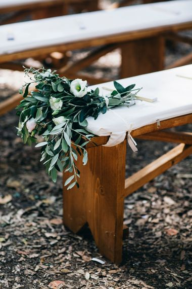 Outdoor Wedding Ceremony Decor | White Flowers and Greenery Pew End | Puglian Countryside Wedding with Fairy Light Altar and Olive Grove Aperitivo | Figtree Wedding Photography
