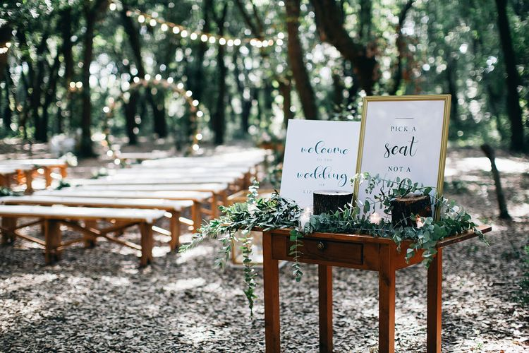 Outdoor Wedding Ceremony Decor | Welcome Sign | Table Decorated with Greenery and Candles | Fairy Light Moon Gate Altar | Festoon Lights | Puglian Countryside Wedding with Fairy Light Altar and Olive Grove Aperitivo | Figtree Wedding Photography